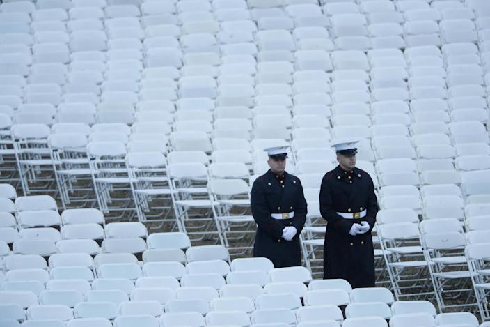 <p>Two U.S. Marines walk between chairs set up on the West Front of the U.S. Capitol on January 20, 2017 in Washington, DC. (Photo: Chip Somodevilla/Getty Images) </p>