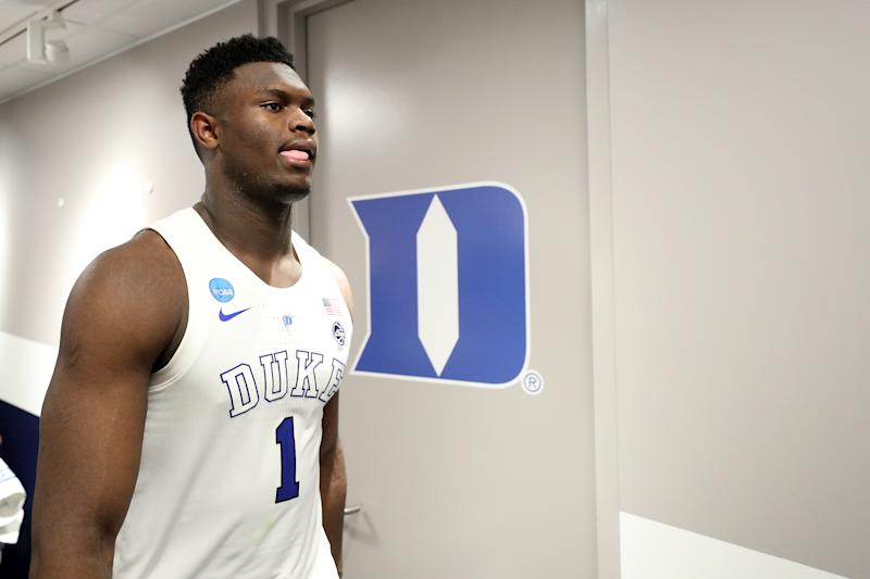 Duke's Zion Williamson reacts in the locker room after his team's 68-67 loss to Michigan State in the East regional game of the 2019 NCAA tournament. (Patrick Smith/Getty Images)