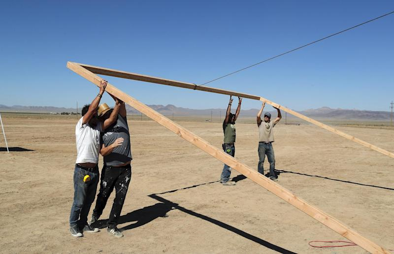 Workers erect a stage at the Little A'Le'Inn on Wednesday, Sept. 18, 2019, in Rachel, Nev: AP Photo/John Locher