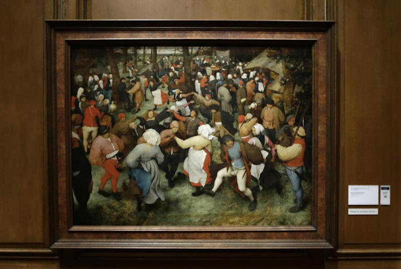 "In a photo from Tuesday, Dec. 10, 2013 at the Detroit Institute of Arts in Detroit, the painting ""The Wedding Dance"" by Pieter Bruegel the Elder, a painting owned by the city of Detroit, is displayed. The fate of Detroit's art is one of the sorer points amid the city's march into bankruptcy. The city purchased many of the pieces in the collection years ago during more prosperous times, which means the works that many consider part of the cultural soul of the city could be considered assets in the bankruptcy to help pay off creditors. (AP Photo/Carlos Osorio)"