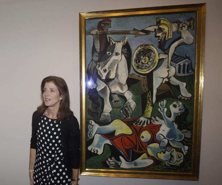 "Caroline Kennedy, president of the John F. Kennedy Library Foundation, unveils Pablo Picasso's painting ""Rape of the Sabine Women"" at the JFK Library and Museum in Boston, Thursday, Oct. 4, 2012. The painting is on loan to the library from the Museum of Fine Arts in commemoration of the upcoming 50th anniversary of the Cuban Missile Crisis, which was Picasso's inspiration for the work. (AP Photo/Stephan Savoia)"