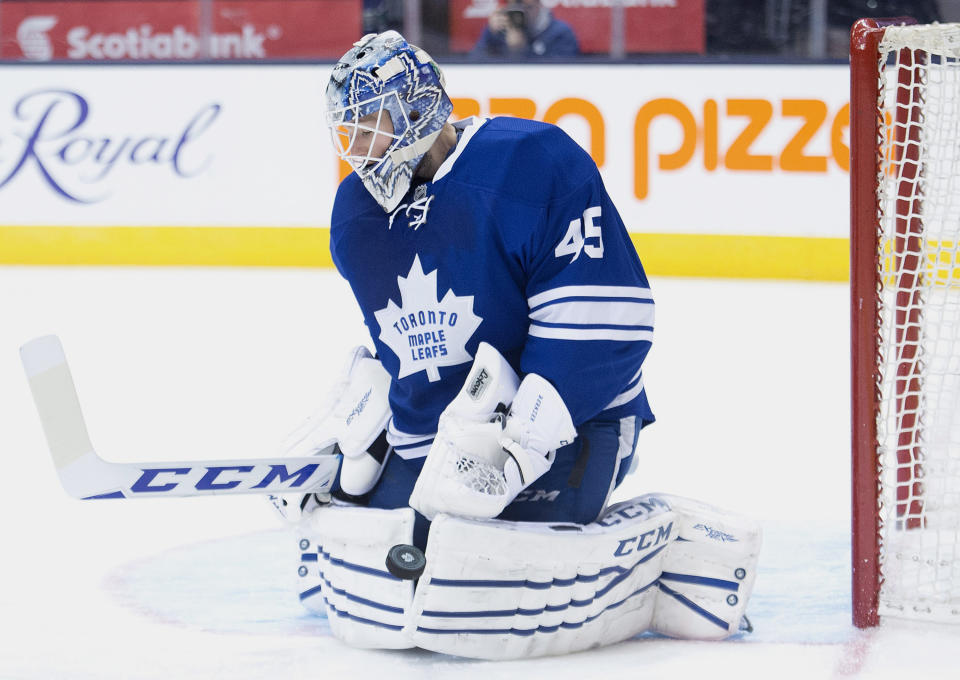 Toronto Maple Leafs goalie Jonathan Bernier makes a save against the Vancouver Canucks during third period NHL hockey action in Toronto on Saturday, Dec. 6, 2014. (AP Photo/The Canadian Press,Nathan Denette)
