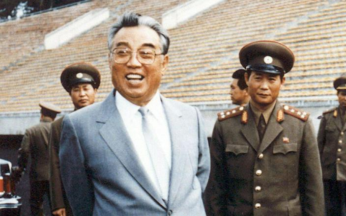 <span>Kim Il-Sung (L), inspecting a football ground in Pyongyang</span> <span>Credit: KNS/AFP/Getty Images </span>