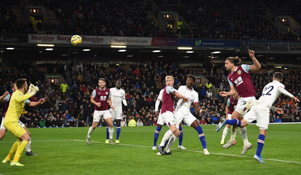 Chelsea's US midfielder Christian Pulisic (R) heads the ball to score their third goal to complete his hattrick during the English Premier League football match between Burnley and Chelsea at Turf Moor in Burnley, north west England on October 26, 2019. (Photo by Oli SCARFF / AFP) / RESTRICTED TO EDITORIAL USE. No use with unauthorized audio, video, data, fixture lists, club/league logos or 'live' services. Online in-match use limited to 120 images. An additional 40 images may be used in extra time. No video emulation. Social media in-match use limited to 120 images. An additional 40 images may be used in extra time. No use in betting publications, games or single club/league/player publications. /  (Photo by OLI SCARFF/AFP via Getty Images)