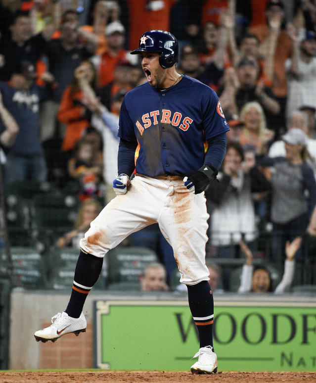 Houston Astros' George Springer reacts after scoring the tying run on Alex Bregman's sacrifice during the eighth inning of the team's baseball game against the Oakland Athletics, Sunday, April 7, 2019, in Houston. (AP Photo/Eric Christian Smith)