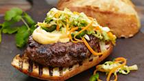 """<p>The banh mi sandwich is an <a href=""""https://www.thedailymeal.com/travel/iconic-street-foods-every-world-traveler-must-try-gallery?referrer=yahoo&category=beauty_food&include_utm=1&utm_medium=referral&utm_source=yahoo&utm_campaign=feed"""" rel=""""nofollow noopener"""" target=""""_blank"""" data-ylk=""""slk:iconic street food everyone has to try at least once"""" class=""""link rapid-noclick-resp"""">iconic street food everyone has to try at least once</a>, and this take on the Vietnamese favorite reimagines it as a burger served with spicy sriracha mayonnaise.</p> <p><a href=""""https://www.thedailymeal.com/best-recipes/vietnamese-burger-sriracha-mayo?referrer=yahoo&category=beauty_food&include_utm=1&utm_medium=referral&utm_source=yahoo&utm_campaign=feed"""" rel=""""nofollow noopener"""" target=""""_blank"""" data-ylk=""""slk:For the Vietnamese Banh Mi Burger With Sriracha Mayo recipe, click here."""" class=""""link rapid-noclick-resp"""">For the Vietnamese Banh Mi Burger With Sriracha Mayo recipe, click here.</a></p>"""