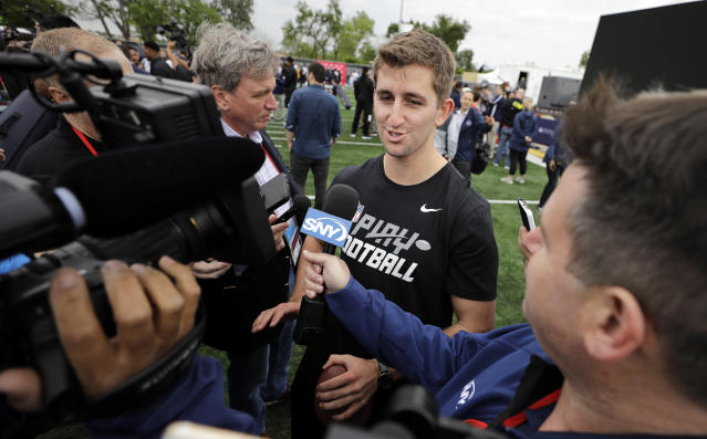 NFL Draft prospect UCLA quarterback Josh Rosen talks with the media after a Play Football Clinic Wednesday, April 25, 2018, in Arlington, Texas. The 2018 NFL Draft begins Thursday, April 26, 2018, at AT&T Stadium. (AP Photo/David J. Phillip)