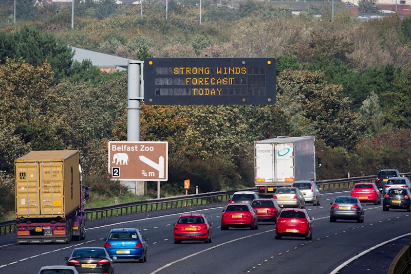 "An overhead road sign on Belfast's M2 motorway warning drivers of, ""Strong Winds Forecast Today"", as Hurricane Ophelia hits the UK and Ireland with gusts of up to 80mph."