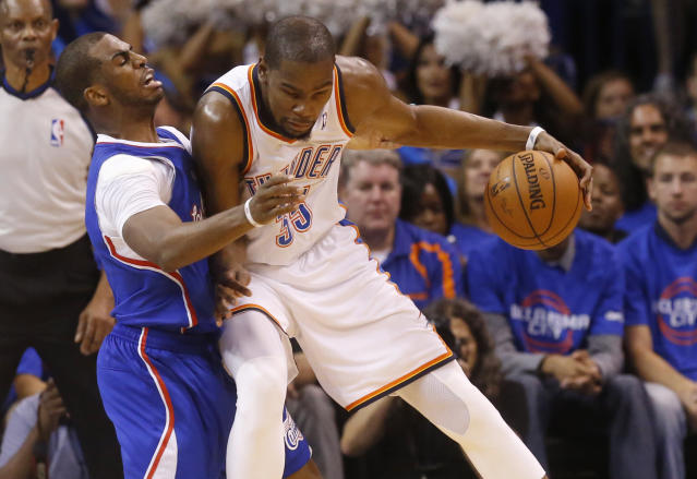 Oklahoma City Thunder forward Kevin Durant, right, drives against Los Angeles Clippers guard Chris Paul, left, in the second quarter of Game 1 of the Western Conference semifinal NBA basketball playoff series in Oklahoma City, Monday, May 5, 2014. (AP Photo/Sue Ogrocki)