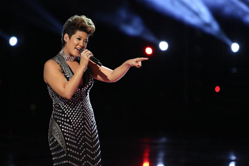 """In this photo provided by NBC, Tessanne Chin sings during the season five finale of """"The Voice"""" on Tuesday, Dec. 17, 2013, in Los Angeles. Chin was announced the season five winner. The 28-year-old Kingston native had nearly given up on her dreams before landing a spot on the NBC singing competition. Chin's coach, Maroon 5 frontman Adam Levine, was also thankful to add a second win to his resume. (AP Photo/NBC, Tyler Golden)"""