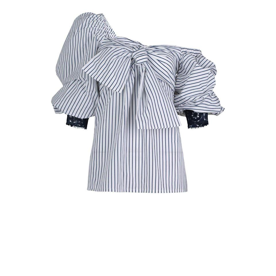 """<p><strong>Silvia Tcherassi</strong></p><p>silviatcherassi.com</p><p><strong>$480.00</strong></p><p><a href=""""https://www.silviatcherassi.com/shop/tops/aosta-blouse?id=4587154866222"""" rel=""""nofollow noopener"""" target=""""_blank"""" data-ylk=""""slk:Shop Now"""" class=""""link rapid-noclick-resp"""">Shop Now</a></p><p>Ever since I can remember, the cotton blouse has been an essential element in my collections. It perfectly embodies the brand's casual luxury approach and attention to detail. Season after season, I revisit this piece, and I have presented it in over a dozen different ways: deconstructed, embellished, with bows or artistic sleeves. I like the timeless appeal of it—any woman of any age can wear it. I also love its versatility, as it can be styled with anything from denim to a silk column evening skirt.</p>"""