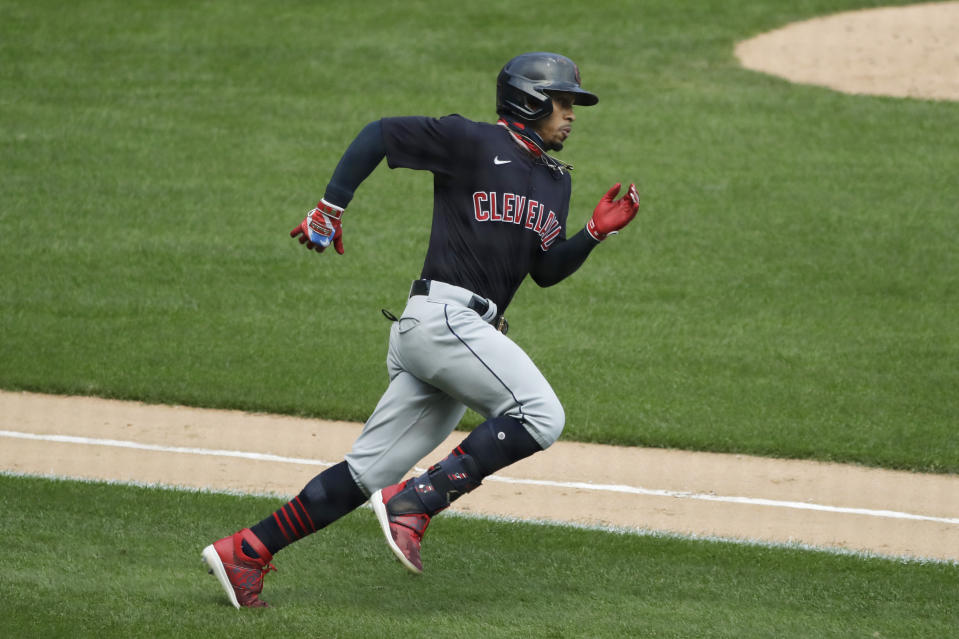 FILE - Cleveland Indians' Francisco Lindor runs after hitting a double against the Chicago White Sox during the fourth inning of a baseball game in Chicago, in this Saturday, Aug. 8, 2020, file photo. The Cleveland Indians have agreed to trade four-time All-Star shortstop Francisco Lindor and pitcher Carlos Carrasco to the New York Mets, a person with direct knowledge of the deal told the Associated Press on Thursday, Jan. 7, 2021.(AP Photo/Nam Y. Huh, File)
