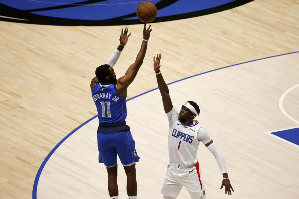 Dallas Mavericks forward Tim Hardaway Jr. (11) shoots a three-point basket against Los Angeles Clippers guard Reggie Jackson (1) in the first half during Game 6 of an NBA basketball first-round playoff series in Dallas, Friday, June 4, 2021. (AP Photo/Michael Ainsworth)