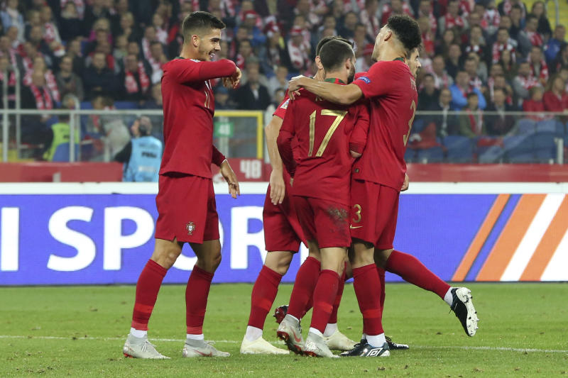 Portuguese players celebrate scoring their side's second goal during the UEFA Nations League soccer match between Poland and Portugal at the Silesian Stadium Chorzow, Poland, Thursday Oct. 11, 2018. (AP Photo/Czarek Sokolowski)
