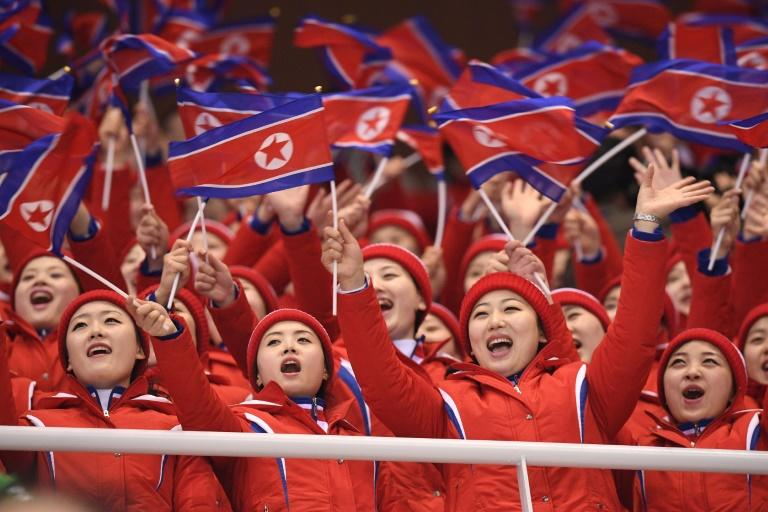 In red uniforms with matching woolly hats, North Korean cheerleaders went en masse to answer the call of nature, returning in a perfectly choreographed move worthy of any gold medal to watch the pair skating