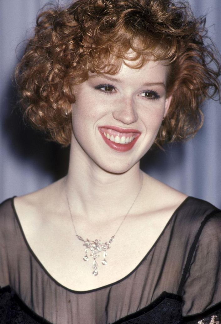 """<p>Molly first appeared on stage at age 3 in a local theater production, but her big acting break was in a West coast production of the Broadway show, <em>Annie. </em>She had a brief stint on the TV series, <em>The Facts of Life</em>, but established herself as the teen queen of the '80s when she starred in the now-iconic movies <em><a href=""""https://www.amazon.com/dp/B001BR7CVG?tag=syn-yahoo-20&ascsubtag=%5Bartid%7C10050.g.24736857%5Bsrc%7Cyahoo-us"""" rel=""""nofollow noopener"""" target=""""_blank"""" data-ylk=""""slk:Sixteen Candles"""" class=""""link rapid-noclick-resp"""">Sixteen Candles</a>, <a href=""""https://www.amazon.com/dp/B001BR3P0S?tag=syn-yahoo-20&ascsubtag=%5Bartid%7C10050.g.24736857%5Bsrc%7Cyahoo-us"""" rel=""""nofollow noopener"""" target=""""_blank"""" data-ylk=""""slk:The Breakfast Club"""" class=""""link rapid-noclick-resp"""">The Breakfast Club</a>, </em>and<em> <a href=""""https://www.amazon.com/dp/B001D0BLTA?tag=syn-yahoo-20&ascsubtag=%5Bartid%7C10050.g.24736857%5Bsrc%7Cyahoo-us"""" rel=""""nofollow noopener"""" target=""""_blank"""" data-ylk=""""slk:Pretty in Pink"""" class=""""link rapid-noclick-resp"""">Pretty in Pink</a>. </em></p>"""