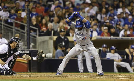 Toronto Blue Jays' Jose Bautista gets out of the way of pitch that is caught by San Diego Padres catcher Nick Hundley, left, and called strike three by umpire Dana DeMuth in the fifth inning of a baseball game in San Diego, Friday, May 31, 2013. (AP Photo/Lenny Ignelzi)