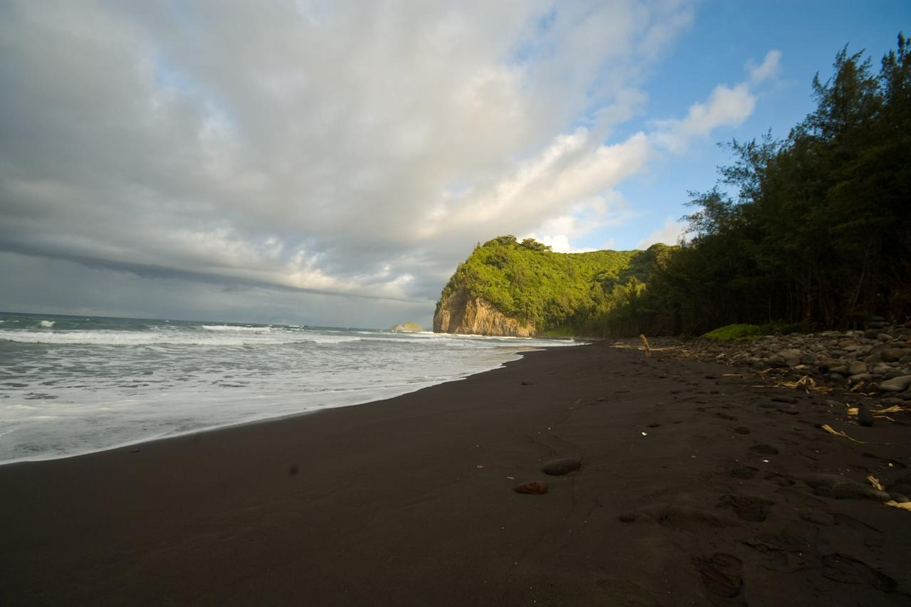 """<p>The eruption of the Kohala Volcano 250,000 - 300,000 years ago created the Kohala coastline on the Big Island's windward coast, which is marked by steep and spectacular sea cliffs. Nestled among those 500-foot cliffs (and at the end of the Pololū Valley <a href=""""https://bigislandhikes.com/pololu-valley"""" target=""""_blank"""">via a half-mile hike</a>) sits this wild beach dotted with polished lava rocks. Note that the waters here are as wild as the scenery: Swimming is dangerous and not advised.</p>"""