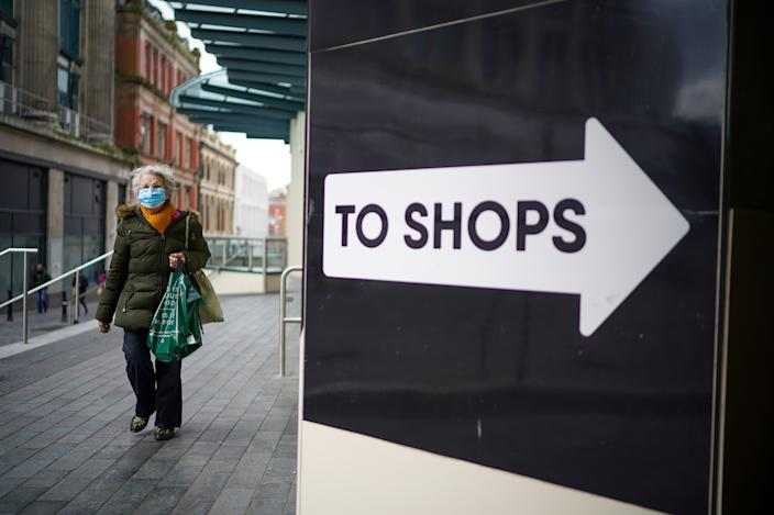 LIVERPOOL, UNITED KINGDOM - APRIL 08: A woman walks to the shops in Liverpool city centre on April 08, 2021 in Liverpool, United Kingdom.  All non-essential retail will be able to reopen from April 12, along with hairdressers, nail salons, bars and restaurants for outdoor table service, libraries and gyms. (Photo by Christopher Furlong/Getty Images)