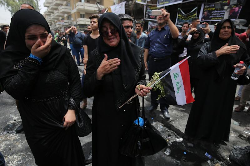 The attack on a Shiite shrine north of Baghdad came just hours after Iraqi Health Minister Adila Hamoud said the death toll from a devastating bombing in Baghdad had reached 292 (AFP Photo/Ahmad al-Rubaye)