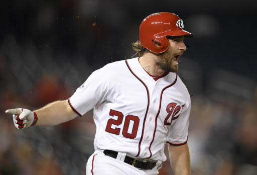 Washington Nationals' Daniel Murphy reacts after he hit a single that drove in two runs during the eighth inning of a baseball game against the Philadelphia Phillies, early Monday, June 25, 2018, in Washington. The Nationals won 8-6. (AP Photo/Nick Wass)