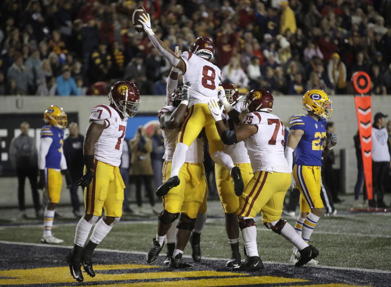 Southern California's Amon-Ra St. Brown (8) celebrates after scoring a touchdown against California during the first quarter of an NCAA college football game Saturday, Nov. 16, 2019, in Berkeley, Calif. (AP Photo/Ben Margot)