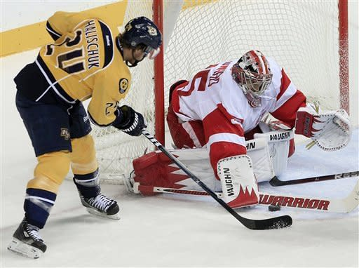 Detroit Red Wings goalie Jimmy Howard (35) blocks a shot by Nashville Predators right wing Matt Halischuk (24) in the second period of an NHL hockey game Monday, Dec. 26, 2011, in Nashville, Tenn. (AP Photo/Mark Humphrey)
