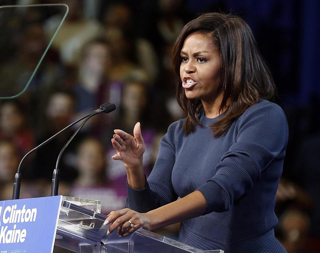 First lady Michelle Obama speaks during a campaign rally for Democratic presidential candidate Hillary Clinton on Oct. 13, 2016, in Manchester, N.H. (Photo: Jim Cole/AP)