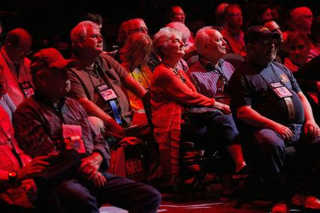 Attendees wait for speakers to start during the National Rifle Association annual leadership forum in Dallas Texas U.S
