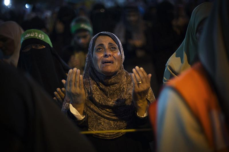 A supporter of Egypt's ousted President Mohammed Morsi reacts while praying during a protest against Egyptian Defense Minister Gen. Abdel-Fattah el-Sissi in Nasr City, Cairo, Egypt, Friday, Aug. 2, 2013. (AP Photo/Manu Brabo)