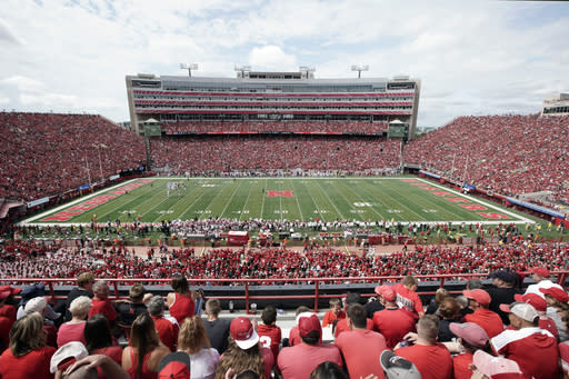 FILE- In this Aug. 31, 2019 file photo, Nebraska fans fill General Memorial Stadium in Lincoln, Neb., during an NCAA college football game between Nebraska and South Alabama. Faced with the possibility college football games will be played in stadiums with reduced capacities as a safeguard against coronavirus, athletic administrators at schools with high ticket demand are making plans to determine who gets a seat. This is a particularly painful task for athletic director Bill Moos of Nebraska, which has sold out every home football game since 1962. The Cornhuskers are a year-round passion in his state. The season ticket renewal rate for the 2020 season is a robust 93 percent. (AP Photo/Nati Harnik, file)