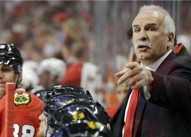 Chicago Blackhawks head coach Joel Quenneville points as he talks to his team during the second period of an NHL hockey game against the Washington Capitals, Tuesday, Oct. 1, 2013, in Chicago. (AP Photo/Nam Y. Huh)