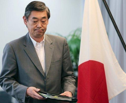 Japanese Foreign Ministry spokesman Yutaka Yokoi arrives for a press conference in Tokyo