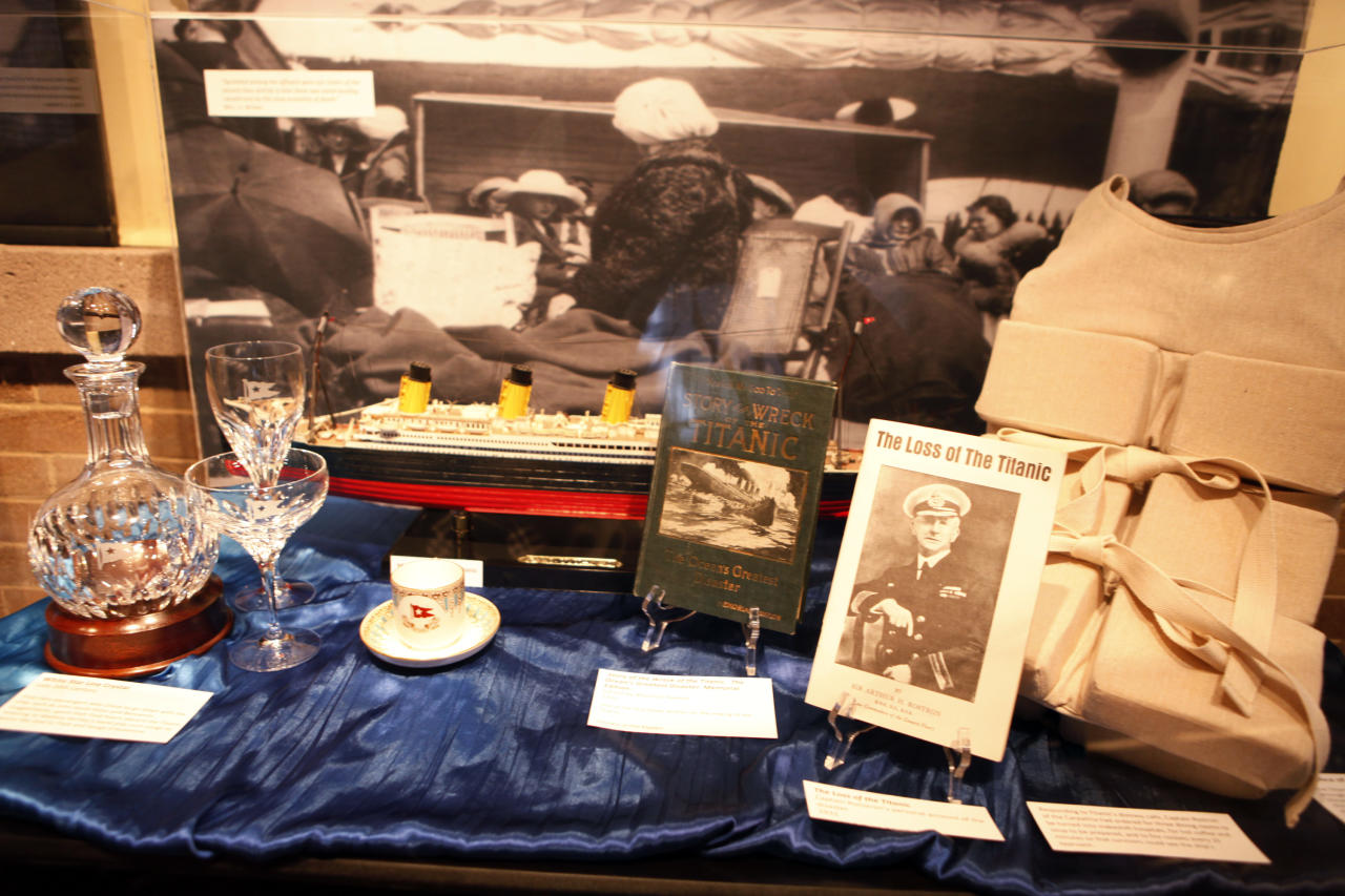 """This March 19, 2012 photo shows a display of memorabilia at the Molly Brown House Museum in Denver. A few blocks from Colorado's state Capitol _ over 1700 miles from the Atlantic Ocean and a mile above sea level _ is a museum dedicated to a woman eclipsed by legend following the sinking of the Titantic. The """"unsinkable Molly Brown"""" moved into this stone Victorian home after she and her husband struck it rich at a gold mine in Colorado's mountains, nearly 20 years before she boarded the Titanic because it was the first boat she could get back home to visit her ailing grandson. (AP Photo/Ed Andrieski)"""