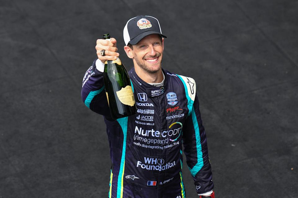 <em>Romain Grosjean toasted to his second runner-up finish of the season on the IMS road course (James Black/IndyCar).</em>