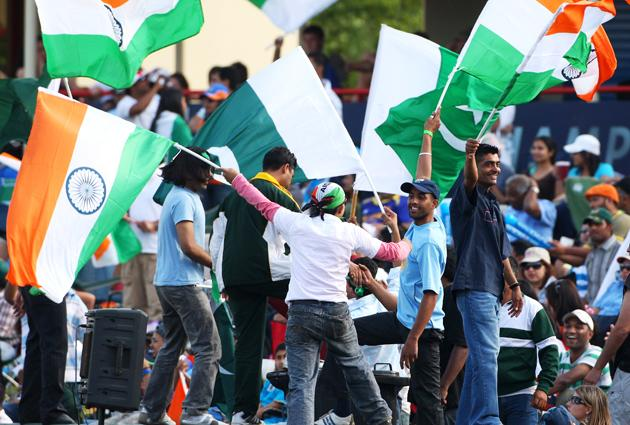 Fans cheer on their team during the  ICC Champions Trophy group A match between India and Pakistan at Centurion on September 26, 2009 in Centurion, South Africa.  (Photo by Tom Shaw/Getty Images)
