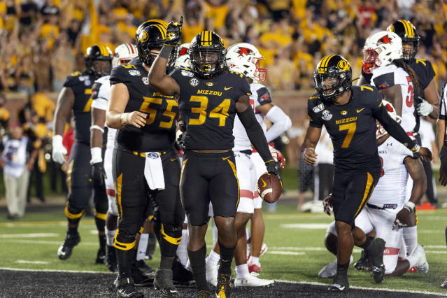 Missouri running back Larry Rountree III (34) celebrates after scoring a touchdown during the second quarter of an NCAA college football game against Southeast Missouri State, Saturday, Sept. 14, 2019, in Columbia, Mo. (AP Photo/L.G. Patterson)