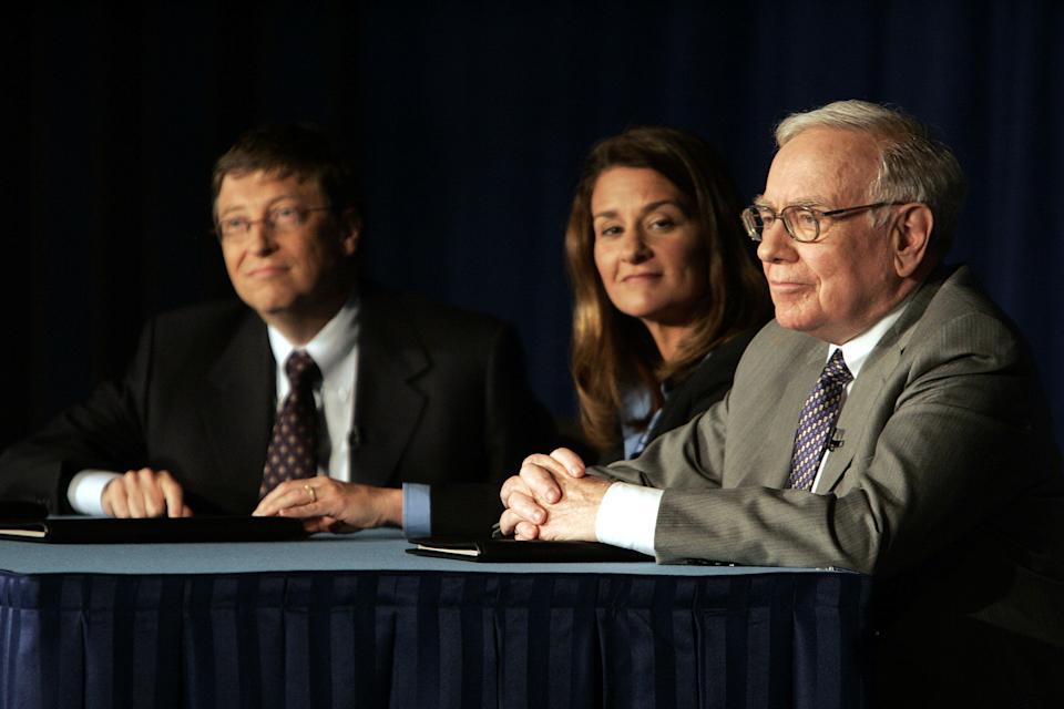 Bill Gates, left, Melinda Gates and Warren Buffett take questions during a press conference Monday, June 26, 2006, in New York.   Buffet, the chairman of Berkshire Hathaway, recently announced his intention of giving 10 million shares of his company to charitable organizations, the majority going to the Bill and Melinda Gates Foundation.  (AP Photo/Seth Wenig)