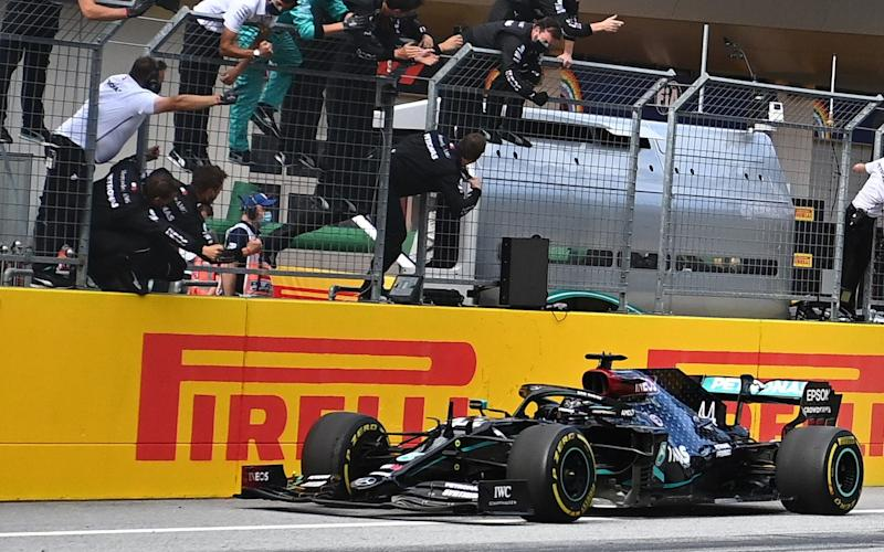 People take pictures as Mercedes' British driver Lewis Hamilton wins the Formula One Styrian Grand Prix race on July 12, 2020 in Spielberg, Austria - AFP/JOE KLAMAR