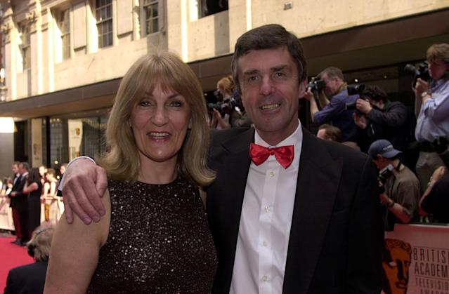 Husband and wife television presenters John Stapleton and Lynn Faulds Wood arrive at the British Academy TV Awards (BAFTA's) in London. (Photo by Rebecca Naden - PA Images/PA Images via Getty Images)