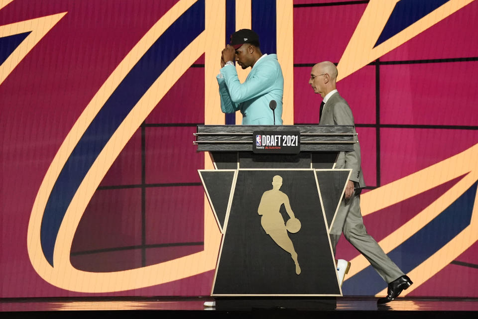 Evan Mobley walks off the stage with NBA Commissioner Adam Silver after being selected third overall by the Cleveland Cavaliers during the NBA basketball draft, Thursday, July 29, 2021, in New York. (AP Photo/Corey Sipkin)