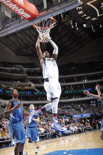 DALLAS, TX - NOVEMBER 12: O.J. Mayo #32 of the Dallas Mavericks dunks against Dante Cunningham #33 of the Minnesota Timberwolves on November 12, 2012 at the American Airlines Center in Dallas, Texas. (Photo by Glenn James/NBAE via Getty Images)