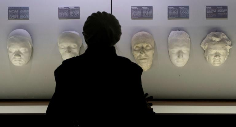 A visitor looks on at death masks of Ludwig Van Beethoven (2nd L), Joseph Hayden (C), Wolfgang Amadeus Mozart (2nd R) and Franz Schubert at the Funeral Museum in Vienna