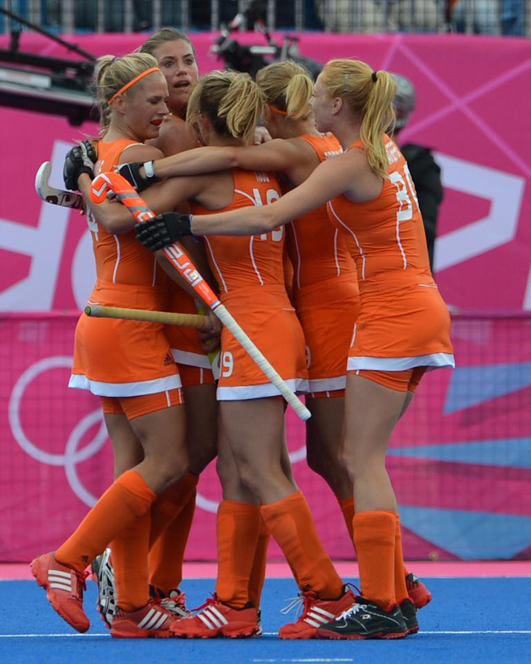 Netherlands players celebrate after scoring a goal during their preliminary round women's field hockey match of the London 2012 Olympic Games between Belgium and Netherlands at the Riverbank Arena in London on July 29, 2012. Netherlands won the match 3-0. AFP PHOTO/ INDRANIL MUKHERJEEINDRANIL MUKHERJEE/AFP/GettyImages