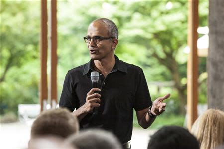 Satya Nadella, executive vice president, Cloud and Enterprise, addresses employees during the One Microsoft Town Hall event in Seattle, Washington in this July 11, 2013 photo made available to Reuters on January 30, 2014. REUTERS/Microsoft/Handout via Reuters