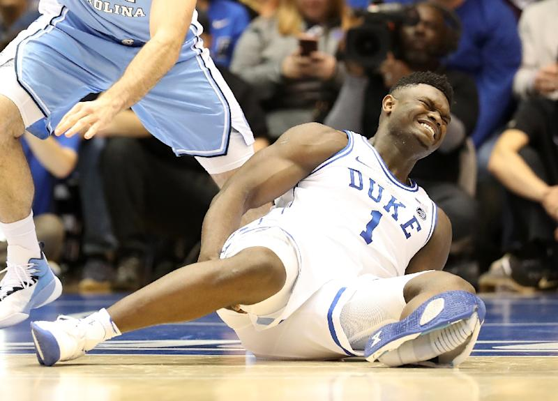 7f4d495f6d2 Duke University star Zion Williamson grimaces in pain after injuring his  knee when his shoe shredded