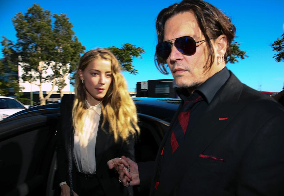Johnny Depp and Amber Heard arriving at a court in the Gold Coast in Australia, on April 18, 2016., to face charges of smuggling her two dogs to Australia.