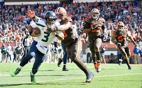 Quarterback Russell Wilson #3 of the Seattle Seahawks is tackled by Sheldon Richardson #98 of the Cleveland Browns during the second quarter at FirstEnergy Stadium on October 13, 2019 in Cleveland, Ohio - Credit: Getty Images