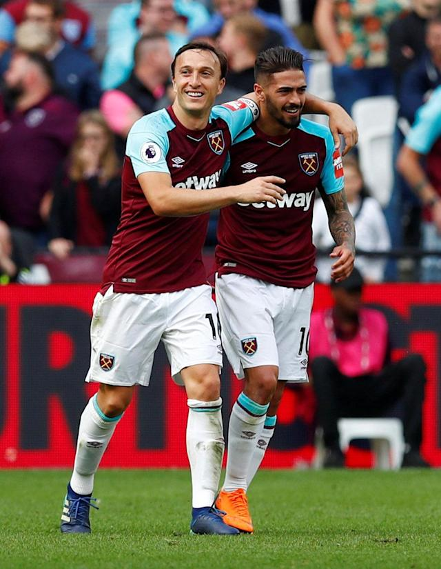 "Soccer Football - Premier League - West Ham United vs Everton - London Stadium, London, Britain - May 13, 2018 West Ham United's Manuel Lanzini and Mark Noble celebrate a goal REUTERS/Eddie Keogh EDITORIAL USE ONLY. No use with unauthorized audio, video, data, fixture lists, club/league logos or ""live"" services. Online in-match use limited to 75 images, no video emulation. No use in betting, games or single club/league/player publications. Please contact your account representative for further details."