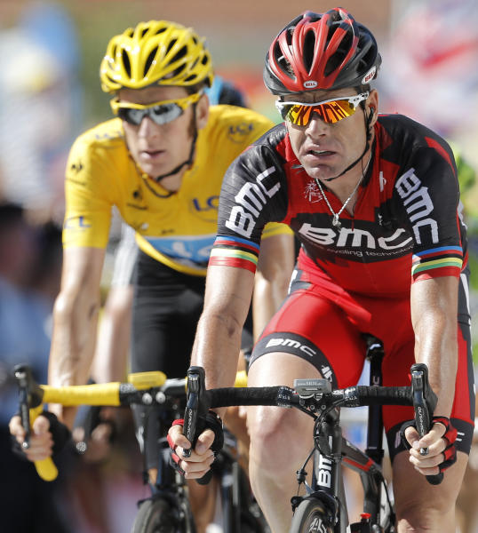 Cadel Evans of Australia, right, and Bradley Wiggins of Britain. wearing the overall leader's yellow jersey, cross the finish line of the 15th stage of the Tour de France cycling race over 158.5 kilometers (98.5 miles) with start in Samatan and finish in Pau, France, Monday July 16, 2012. (AP Photo/Laurent Cipriani)